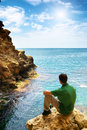 Man in sea cave composition of nature Royalty Free Stock Photography