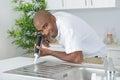 Man sealing edge kitchen sink Royalty Free Stock Photo