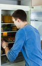 Man searching for something in refrigerator at home Stock Images