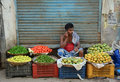 A man selling fresh fruits at market in Delhi, India