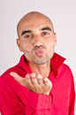 Man sending a kiss romantic funny blowing dressed in red shirt for valentine's day Royalty Free Stock Photography