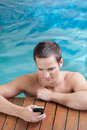 Man sending a message inside the pool Royalty Free Stock Photo