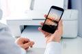 Man sending a photo to wireless printer Royalty Free Stock Photo
