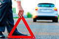Man sets the warning triangle Royalty Free Stock Photo