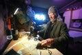 Man sewing fabric Royalty Free Stock Photo