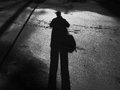 Man shadow from the on the road Stock Image