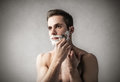 Man shaving his face Royalty Free Stock Photo