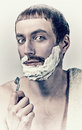 Man shaving portrait of a in vintage style Royalty Free Stock Images