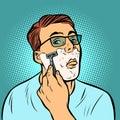 Man shaving razors