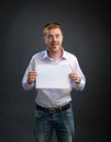 Man with a sheet of paper in his hands Royalty Free Stock Photo