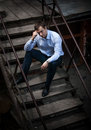 Man in shirt sitting on stairs handsome Royalty Free Stock Photography