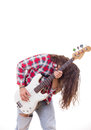 Man in shirt with tousled hair playing electric bass guitar Stock Photo