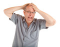Man in shock just got very bad news holding his head disbelief and shocked Royalty Free Stock Photo