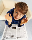 Man shocked by bad news from newspaper Stock Photography