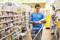 Man shopping hardware store handsome young for tools at Royalty Free Stock Photography