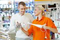 Man shopping at home appliance supermarket young men choosing electric blender in mall Stock Photos