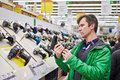 Man shopping for screwdriver in hardware store Royalty Free Stock Photo