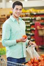 Man shopping at store young tomato food in vegetable or supermarket Royalty Free Stock Photo