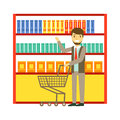 Man shopping at supermarket with shopping cart and buying products. Shopping in grocery store, supermarket or retail