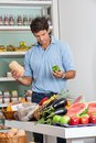 Man shopping vegetables in supermarket mid adult Stock Images