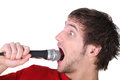 Man shouting into a microphone Stock Images