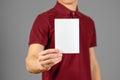 Man showing blank white flyer brochure booklet. Leaflet presentation