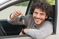 Man showing car key portrait of young happy the sitting in new Royalty Free Stock Photo