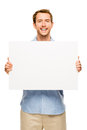 Man showing empty space white placard happy young Stock Photo