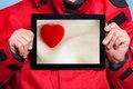 Man showing heart love symbol on tablet touchpad Royalty Free Stock Photo
