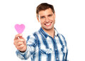 Man showing pink paper heart Stock Image
