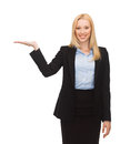 Man showing something imaginary on her hand smiling woman Stock Photography