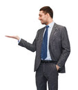 Man showing something on the palm of his hand business office advertising and people concept friendly young buisnessman Royalty Free Stock Photography