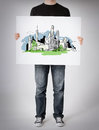 Man showing white board with city sketch Royalty Free Stock Photo