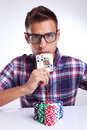 Man shows his poker hand Royalty Free Stock Photo