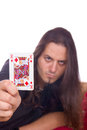 Man shows the king of spades with mystic look Stock Photography