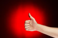 Man shows thumb up over red background Stock Photo
