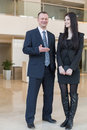 A man shows on woman with a notepad men in business suit his hand women Stock Photo