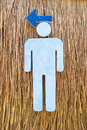 Man sign made of foam on vetiver grass wall and arrow the way to toilet Stock Photography