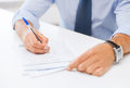 Man signing a contract business office school and education concept Royalty Free Stock Images
