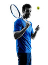 Man silhouette playing tennis player one caucasian in studio isolated on white background Royalty Free Stock Photos