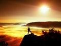 Man silhouette on the sharp peak. Satisfy hiker enjoy view. Royalty Free Stock Photo