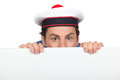 Man in a silly sailor's hat Royalty Free Stock Photo