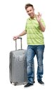 Man with silver suitcase gesturing ok full length portrait of isolated on white concept of traveling and cool vacations Royalty Free Stock Photo