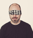 Man with sin blindfold a a covering his eyes that spells Royalty Free Stock Image