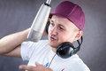Man singing in the studio headphones Stock Image