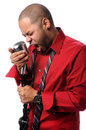 Man singing Into Vintage Microphone Stock Photo