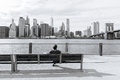 The man sits and admire of the downtown of new york usa september on bench Royalty Free Stock Images