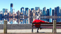 Man sitting on bench Manhattan skyline Royalty Free Stock Image