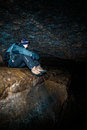 A man sitting in a cave. Stock Photo