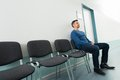 Man sitting on chair in hospital Royalty Free Stock Photo